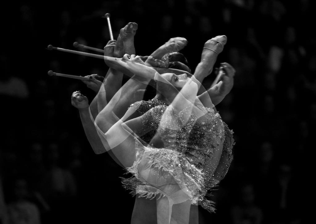 Dalia Kutkaitė. CUP gimnastikos varžybos Vilniuje. Fotografija daryta su keturguba ekspozicija.